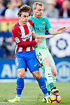Antoine Griezmann of Atletico de Madrid competes for the ball with Jeremy Mathieu of FC Barcelona during their La Liga match between Atletico de Madrid and FC Barcelona at the Santiago Bernabeu Stadium on 26 February 2017 in Madrid, Spain. Photo by Diego Gonzalez Souto / Power Sport Images