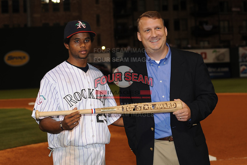 AAsheville Tourists Eliezer Mesa presented by Eric Krupa the Top Star Award South Atlantic League All Star Game at Fluor Field in Greenville, South Carolina June 22, 2010.   The game ended in a 5-5 tie.  Photo By Tony Farlow/Four Seam Images