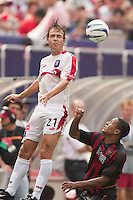 Justin Mapp of the Fire goes for a header as Ricardo Clark of the MetroStars watched. The Chicago Fire defeated the NY/NJ MetroStars 3-2 on 6/14/03 at Giant's Stadium, NJ..