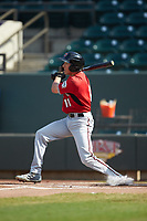 Ryan Aguilar (11) of the Carolina Mudcats follows through on his swing against the Winston-Salem Dash at BB&T Ballpark on June 1, 2019 in Winston-Salem, North Carolina. The Mudcats defeated the Dash 6-3 in game one of a double header. (Brian Westerholt/Four Seam Images)
