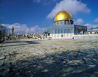 The golden dome of the Dome of the Rock (Al Quds - The Holy) shining in early morning sunlight under a deep blue sky, on the Noble Rock, Jerusalem, Israel