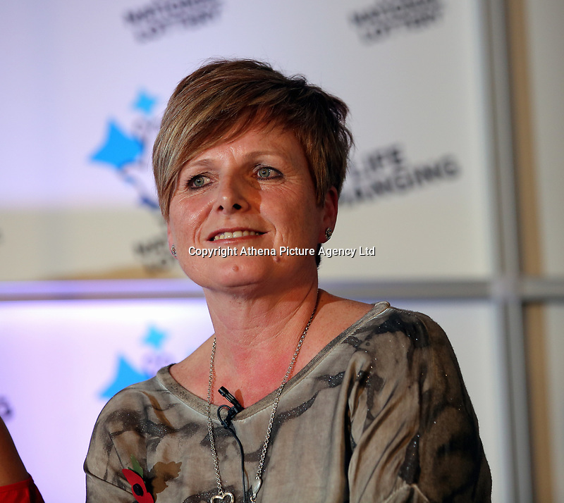 Pictured: Julie Amphlett. Wednesday 08 November 2017<br /> Re: Presentation of hospital catering syndicate win £25m in Euromillions Jackpot at Hensol Castle, south Wales, UK. Julie Saunders, 56, Doreen Thompson, 56, Louise Ward, 37, Jean Cairns, 73, SIan Jones, 54 and Julie Amphlett, 50 all work as catering staff for Neath Port Talbot Hospital in south Wales.
