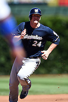 Milwaukee Brewers first baseman Lyle Overbay (24) running the bases during a game against the Chicago Cubs on August 14, 2014 at Wrigley Field in Chicago, Illinois.  Milwaukee defeated Chicago 6-2.  (Mike Janes/Four Seam Images)