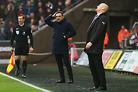 Swansea City manager Carlos Carvalhal looks confused after Aaron Lennon of Burnley tackles Martin Olsson of Swansea City and no card if given whilst Burnley manager Sean Dyche looks dejected during the Premier League match between Swansea City and Burnley at the Liberty Stadium, Swansea, Wales, UK. Saturday 10 February 2018