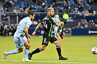 KANSAS CITY, KS - MAY 9: Diego Fagundez #14 Austin FC with the ball challenged by Graham Zusi #8 Sporting KC during a game between Austin FC and Sporting Kansas City at Children's Mercy Park on May 9, 2021 in Kansas City, Kansas.