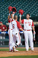 Brett Kinneman (6) of the North Carolina State Wolfpack celebrates a home run with Brad Debo (12) against the Boston College Eagles in Game Two of the 2017 ACC Baseball Championship at Louisville Slugger Field on May 23, 2017 in Louisville, Kentucky. The Wolfpack defeated the Eagles 6-1. (Brian Westerholt/Four Seam Images)