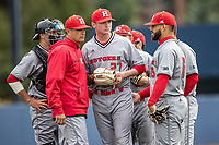 Rutgers Scarlet Knights pitcher Tommy Genuario (27) talks on the mound with head coach Joe Litterio against the Michigan Wolverines on April 27, 2019 in the NCAA baseball game at Ray Fisher Stadium in Ann Arbor, Michigan. Michigan defeated Rutgers 10-1. (Andrew Woolley/Four Seam Images)