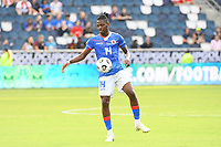 KANSAS CITY, KS - JULY 15: Leverton Pierre #14 of Haiti with the ball during a game between Canada and Haiti at Children's Mercy Park on July 15, 2021 in Kansas City, Kansas.