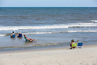 Avon, Outer Banks, North Carolina. Vacationers Waiting for the Tide.
