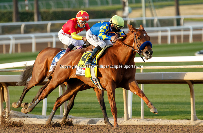 ARCADIA, CA DECEMBER 26: #4 Charlatan, ridden by Mike Smith takes over the lead from #3 Nashville, ridden by Ricardo Santana, Jr., battle for the lead entering the stretch of the Runhappy Malibu Stakes (Grade l) on December 26, 2020 at Santa Anita Park in Arcadia, CA. (Photo by Casey Phillips/EclipseSportswire/CSM)