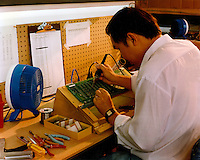 File, Montreal (Quebec) CANADA<br /> <br /> Soldering an electronic board<br /> Photo (c)  Pierre Roussel/ Images Distribution