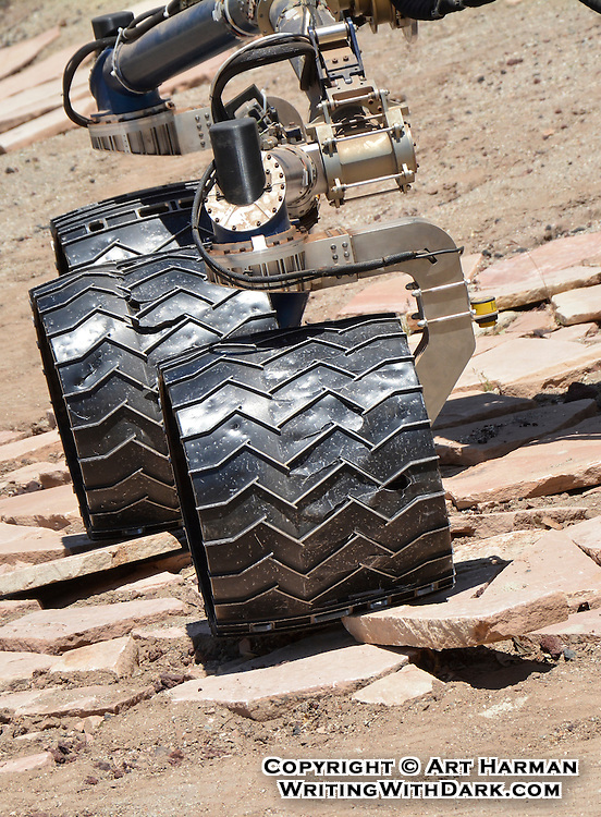 """""""Curiosity not on Mars"""" by Art Harman. NASA's Jet Propulsion Laboratory tests the duplicate Mars rovers at their """"Mars Yard,"""" and one afternoon I got to get close up with it as it drove around an obstacle course. These are the wheels."""