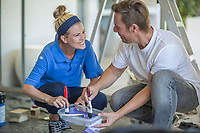 couple painting home together