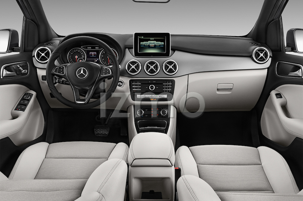 Stock photo of straight dashboard view of 2016 Mercedes Benz B-Class Inspiration 5 Door Mini MPV Dashboard
