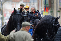 Pictured: Brian May on a horse cart. Thursday 26 December 2019<br /> Re: Guitarist Brian May of Queen has joined the Boxing Day Hunt in Wind Street, Swansea, Wales, UK.