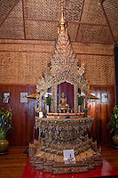 Myanmar, Burma.  Burmese Family Shrine, a copy of a 200-year-old shrine in the Nga Hpe Kyaung Monastery, Inle Lake, Shan State.