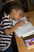 Surman, Libya.  Boy Practicing Penmanship in the Madrasa of Sidi Rashid al-Galili.   Boys may wear traditional garments, but western or European sport shirts or T-shirts are more popular.