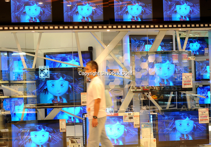 A consumer walk passes the new LCD TVs outside a LG TV shop in Hong Kong. LG Electronics, a multinational company is the 2nd largest electronic products maker of South Korea and third largest appliance maker in the world. With LG's intelligent sensor technology, its LCD TVs provide a better viewing experience along with its energy efficiency that only uses 69.5% less power for its consumers. .