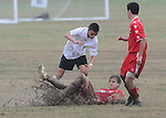 A Lafreniere player goes to the ground during sloppy conditions in Baton Rouge. Lafreniere went on to win 1-0 on a last second goal.
