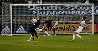 KANSAS CITY, KS - OCTOBER 07: #27 Gianluca Busio of Sporting Kansas City shoots on goal as #1 Bobby Shuttleworth of Chicago Fire FC prepares to stop the ball during a game between Chicago Fire and Sporting Kansas City at Children's Mercy Park on October 07, 2020 in Kansas City, Kansas.