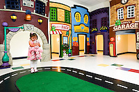 A young girl in a pink dress enters a high end child care and day care facility in Mooresville, NC.
