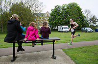 10 MAY 2015 - ST. NEOTS, GBR - Young spectators watch competitors in the 2015 British Sprint Triathlon Championships running through Riverside Park in St. Neots, Great Britain (PHOTO COPYRIGHT © 2015 NIGEL FARROW, ALL RIGHTS RESERVED)