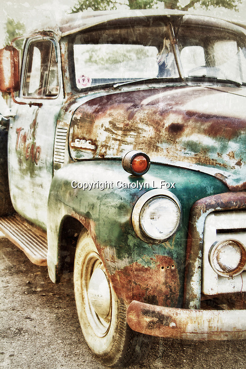 An old rusty truck sits in a small Montana town.