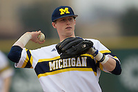 Michigan Wolverines third baseman Jacob Cronenworth (2) in action during the NCAA baseball game against the Washington Huskies on February 16, 2014 at Bobcat Ballpark in San Marcos, Texas. The game went eight innings, before travel curfew ended the contest in a 7-7 tie. (Andrew Woolley/Four Seam Images)