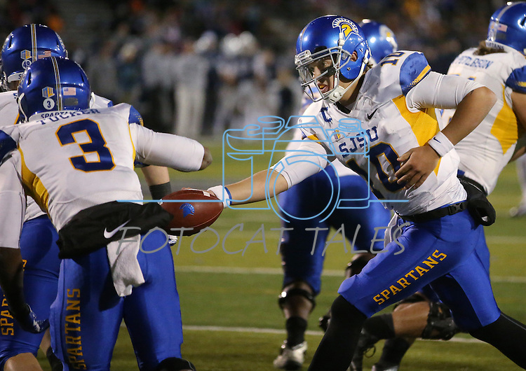 San Jose State's David Fales hands off to Thomas Tucker in an NCAA college football game against Nevada, in Reno, Nev., on Saturday, Nov. 16, 2013. (AP Photo/Cathleen Allison)