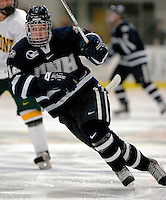"5 January 2007: University of New Hampshire forward Bobby Butler (12) from Marlborough, MA, in action against the University of Vermont Catamounts at Gutterson Fieldhouse in Burlington, Vermont. The UNH Wildcats defeated Vermont 7-1 in front of a record setting 48th consecutive sellout at ""the Gut""...Mandatory Photo Credit: Ed Wolfstein Photo.<br />"