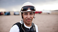 Mexican jockey, Ruperto Rosas at a local race meeting in Dodge CIty, Kansas. Horse racing is a favourite past time of many of the Hispanic migrant workers who have come to the area to work in its meat packing plants.
