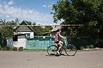 UKRAINE, Pisky: a young lady riding a bike just a few kilometres from the frontline.<br /> <br /> UKRAINE, Pisky: Une jeune femme roule à vélo à seulement quelques kilomètres de la ligne de front.