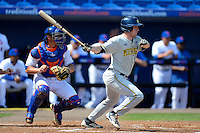 Michigan Wolverines infielder Travis Maezes #9 bats in front of catcher Anthony Recker #20 during an exhibition game against the New York Mets at Tradition Field on February 24, 2013 in St. Lucie, Florida.  New York defeated Michigan 5-2.  (Mike Janes/Four Seam Images)