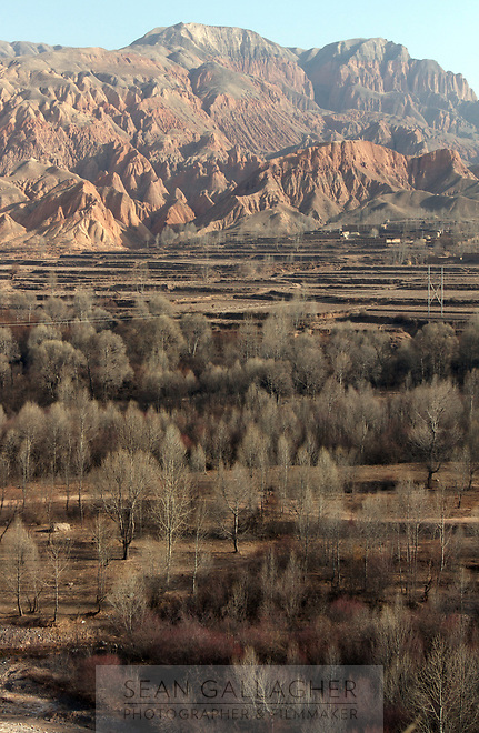 Forests and mountains near the town of Rebgong (Chinese name - Tongren) on the Qinghai-Tibetan Plateau. China.