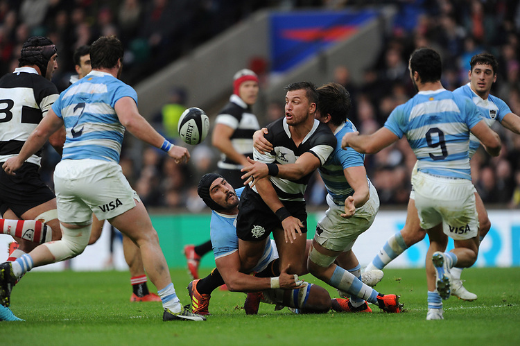 Handre Pollard Barbarians (Bulls & South Africa) offloads in the tackle during the Killik Cup match between the Barbarians and Argentina at Twickenham Stadium on Saturday 1st December 2018 (Photo by Rob Munro/Stewart Communications)