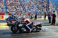 Jul. 1, 2012; Joliet, IL, USA: NHRA pro stock motorcycle rider Hector Arana Sr (near lane) races alongside Michael Phillips during the Route 66 Nationals at Route 66 Raceway. Mandatory Credit: Mark J. Rebilas-