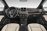 Stock photo of straight dashboard view of 2017 Mercedes Benz B-Class Electric-Drive 5 Door Mini MPV Dashboard