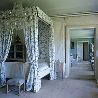 To the left of the canopied bed in the master bedroom stands an 18th century dolls' house