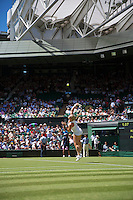 England, London, June 30, 2015, Tennis, Wimbledon, Kiki Bertens (NED) serving on Centercourt<br /> Photo: Tennisimages/Henk Koster