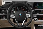 Car pictures of steering wheel view of a 2020 BMW X4 xDrive30i 5 Door SUV
