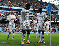 Picture: Andrew Roe/AHPIX LTD, Football, Barclays Premier League, Manchester City v Swansea City, 22/11/14, Etihad Stadium, K.O 3pm<br /> <br /> Swansea's Wilfred Bony (centre) celebrates his goal<br /> <br /> Andrew Roe>>>>>>>07826527594