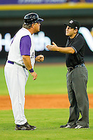 Winston-Salem Dash manager Tommy Thompson #39 has a discussion with base umpire Rich Gonzalez during the Carolina League game against the Potomac Nationals at BB&T Ballpark on June 13, 2012 in Winston-Salem, North Carolina.  The Dash defeated the Nationals 5-3.  (Brian Westerholt/Four Seam Images)