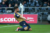 Olivier Giroud of Arsenal celebrates scoring his goal to make the score 0-1 during the Barclays Premier League match between Swansea City and Arsenal played at The Liberty Stadium, Swansea on October 31st 2015