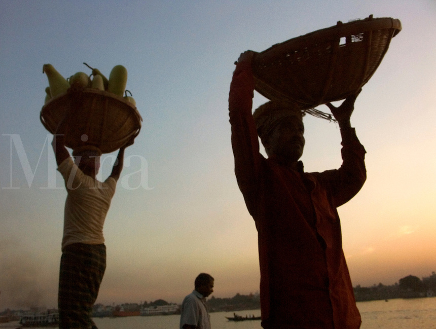 December, 2003 Laborers unload ships in the harbor on the Buriganga river in Old Dacca, Bangladesh