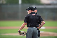 Home plate umpire Bobby Tassone before a Pioneer League game between the Billings Mustangs and Ogden Raptors at Lindquist Field on August 17, 2018 in Ogden, Utah. The Billings Mustangs defeated the Ogden Raptors by a score of 6-3. (Zachary Lucy/Four Seam Images)