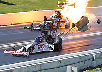 May 21, 2017; Topeka, KS, USA; NHRA top fuel driver Steve Torrence (near) defeats Clay Millican as he explodes an engine on fire during the Heartland Nationals at Heartland Park Topeka. Mandatory Credit: Mark J. Rebilas-USA TODAY Sports