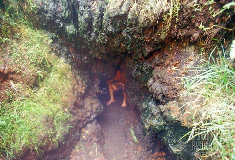 Man in natural hot steam vents in the jungle near Pahoa, Big Island of Hawaii