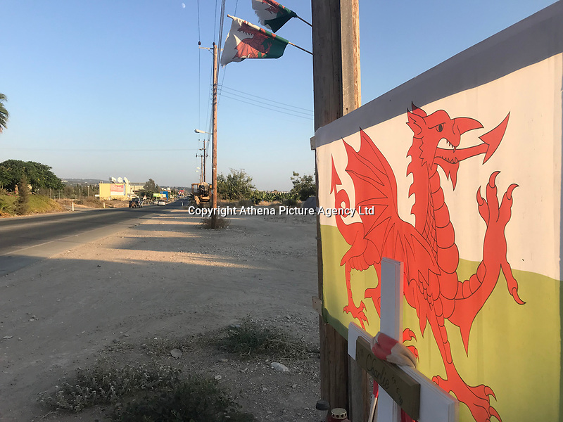 """Pictured: A welsh flag and tributes are left on the spot where Robert """"Charlie"""" Birch was killed on a road in Pafos, Cyprus. Wednesday 19 September 2018<br /> Re: A man charged with the murder of Welsh holidaymaker Robert Birch, who is known as Charlie, has appeared in court in Cyprus.<br /> 39-year-old Charlie Birch, was killed in a hit-and-run crash, on the Peyia-Ayios Georghios road in Paphos in the early hours of the morning. Another man, aged 32, was injured.<br /> Under Cypriot law, the defendant can not be identified."""