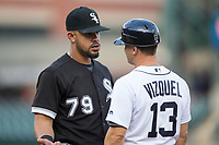 Chicago White Sox first baseman Jose Abreu (79) chats with Detroit Tigers first base coach Omar Vizquel (13) during the game at Comerica Park on June 2, 2017 in Detroit, Michigan.  The Tigers defeated the White Sox 15-5.  (Brian Westerholt/Four Seam Images)