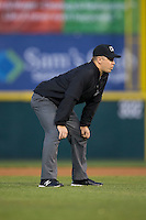 Umpire Matt Carlyon handles the calls on the bases during the South Atlantic League game between the Rome Braves and the Hickory Crawdads at L.P. Frans Stadium on May 12, 2016 in Hickory, North Carolina.  The Braves defeated the Crawdads 3-0.  (Brian Westerholt/Four Seam Images)